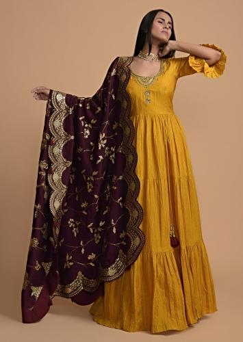 Mustard Yellow Tiered Anarkali Suit With Frill Sleeves And Purple Brocade Dupatta Online - Kalki Fashion