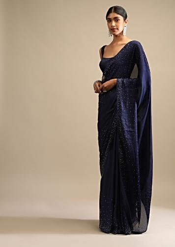 Navy Blue Saree In Satin Embellished With Scattered Red And Silver Kundan Along The Border And Unstitched Blouse Online - Kalki Fashion