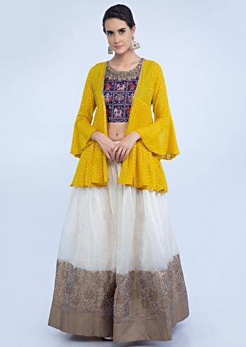 2a2bf2104 Off white floral brocade lehenga with navy blue batik printed crop top and  yellow georgette jacket