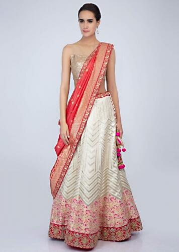 049b2c7811 Off white floral embroidered brocade silk lehenga with contrasting peach  dupatta only on Kalki