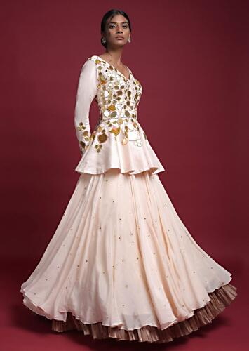 Off White Peplum Top With Flower And Leaf Cut Mirror Work And Matching Lehenga Online - Kalki Fashion