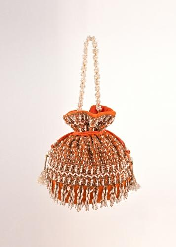 Orange Potli In Velvet Heavily Embroidered With Beads And Moti Work In Scalloped And Tassel Design By Shubham
