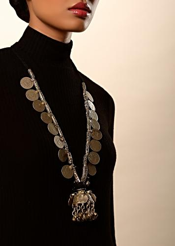 Oxidised Antique Necklace With Coins And Carved Beads And A Dome Shaped Pendant Featuring Ghungru Tassels By Kohar
