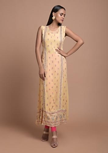 Pale Yellow Kurti In Georgette With Double Front Slits And Colorful Resham Embroidered Buttis Online - Kalki Fashion