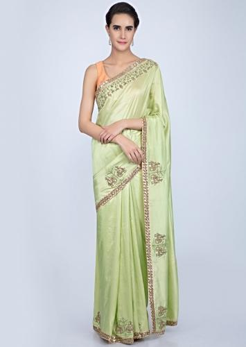 1892ddbeb7 Parrot green dupion silk saree with embroidered butti and border in human  and elephant motif only