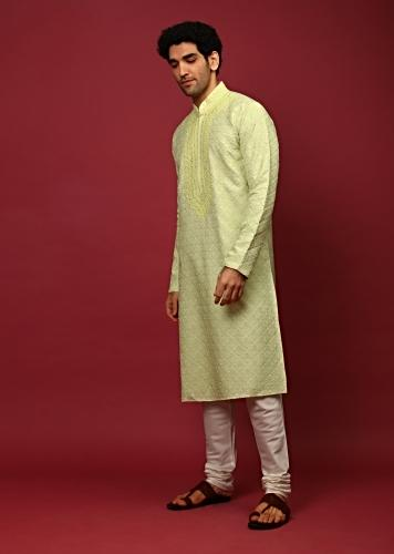 Pastel Green Kurta Set In Raw Silk Heavily Embroidered With Resham And Mirror Embroidered Floral Buttis Online - Kalki Fashion