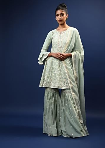 Pastel Green Sharara Peplum Suit In Cotton With Pastel And White Thread Embroidered Floral Motifs And Ruffle Sleeves Online - Kalki Fashion