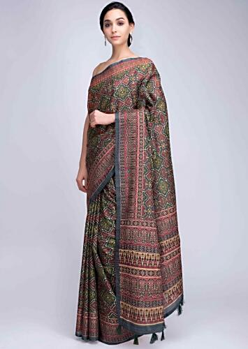 fd4146523 Patola printed green silk saree with tassels on the pallo only on Kalki
