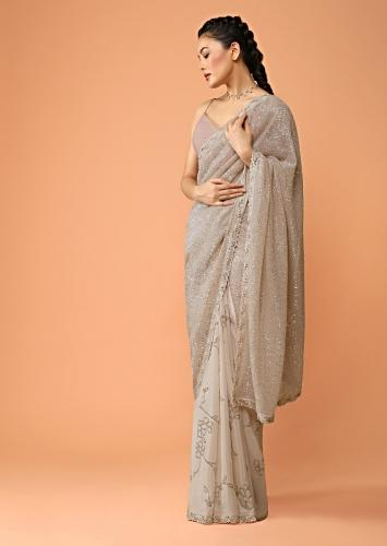 Peachy Beige Half And Half Saree In Crepe With Sequins Embellished Floral Motifs And Sequins Lycra Pallu Online - Kalki Fashion