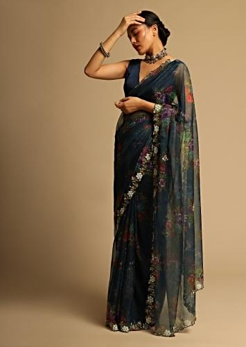 Peacock Blue Saree In Organza With Floral Print All Over And Moti Embroidered Border Along With Unstitched Blouse Online - Kalki Fashion