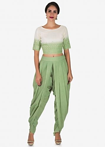 2b2e09ae105124 Pista green and white dhoti suit adorn in beautiful thread work only on  Kalki