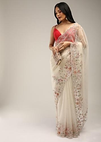 Powder White Saree In Organza With Multi Colored Sequins And Pita Zari Embroidered Floral Motifs On The Border Online - Kalki Fashion