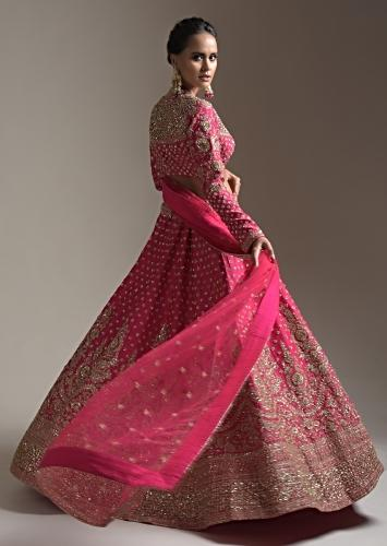 Rani Pink Lehenga Choli In Raw Silk With Heavy Embroidery Work In Heritage Floral Design And Butti Work Online - Kalki Fashion