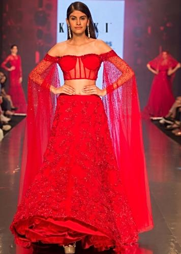 8f8361e5729 Ruby red heavy embroidered net lehenga with fancy off shoulder blouse with  long fared sleeves only