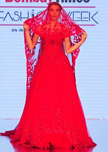 0c88ffaf90d Ruby red gown with a long head trail with pleated net border only on kalki