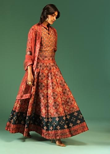 Rust Orange Anarkali Suit In Raw Silk With Patola Print And Kundan Detailing Along With A Rust Net Dupatta Online - Kalki Fashion