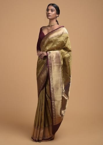Sage Green Pure Handloom Saree In Silk With Woven Floral Buttis And Purple Border Online - Kalki Fashion