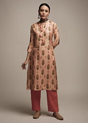 Peach Straight Cut Kurti In Cotton Silk With Floral Printed Buttis And Tassels On The Placket Online - Kalki Fashion