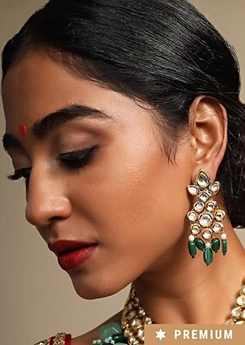Gold Plated Earrings With Polki Work In Floral Motifs Along With Dangling Green Beads By Prerto
