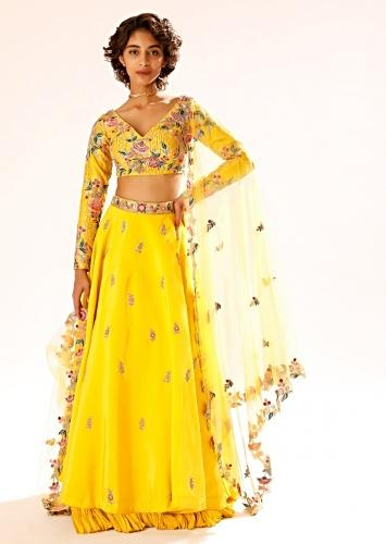 Sun Yellow Lehenga With Hand Embroidered Buttis And Colorful Resham Work In Floral Motifs On The Choli Online - Kalki Fashion