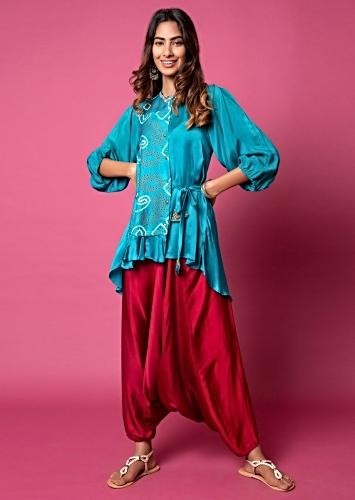 Teal Frill Shirt With Bandhani Printed Paisley Motifs, Puff Sleeves And Paired With Scarlet Red Cowl Pants Online - Kalki Fashion