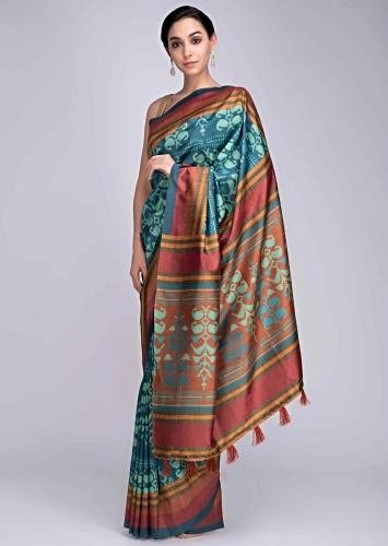 e7cebd9097 Turq blue silk saree in ikkat print and multi color striped only on Kalki