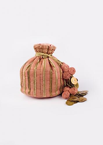 Pink Potli With Two toned gold cut dana work in striped design By Vareli Bafna