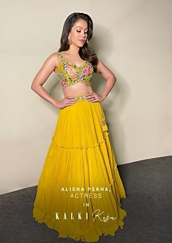 Waluscha De Sousa In Kalki Tuscan Sun Yellow Tiered Lehenga Choli In Georgette With Colorful Resham Embroidered Floral Motifs