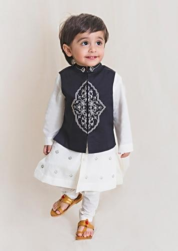 White Kurta Set With Embroidered Buttis And Black Nehru Jacket With Ornate Embroidered Motif By Tiber Taber