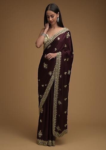 Wine Purple Saree In Satin With Hand Embroidered Floral Buttis Using Cut Dana And Sequins Work Online - Kalki Fashion