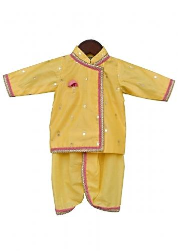 Yellow Dhoti Suit With Angrakha Styled Kurta Having Foil Printed Buttis By Fayon Kids