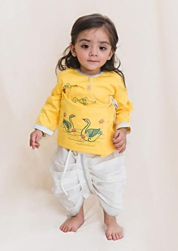 Yellow Kurta And White Dhoti Set In Cotton With Thread And Zari Embroidered Swan Motifs By Tiber Taber